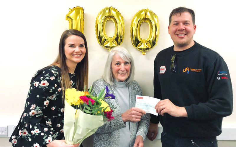 Loren and James Radwell with the winner of the 100th boiler installation