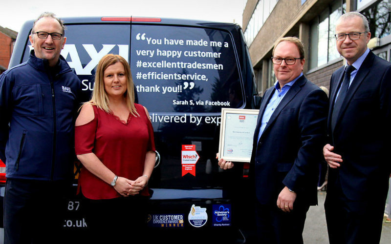Baxi team members receiving their certificate from Which? Trusted Traders