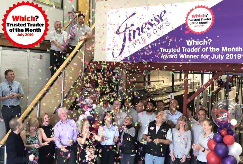 The Finesse Windows team celebrating their Trader of the Month title