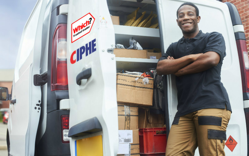 Trader stood next to his van with Trusted Trader and CIPHE logos on it