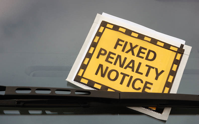 A parking fine on a windscreen