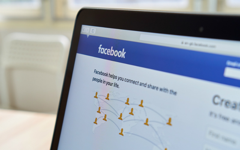 Facebook log in page shown on a laptop screen