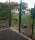 Square thumb replacement fencing  gate and posts around tennis court