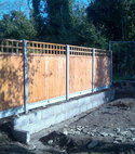 Square thumb trellis topped closeboard panels on concrete