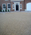Square thumb chippings in macadam driveway