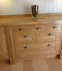 Square thumb oak drawer chest