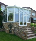 Square thumb mini a hazlemere aluminium conservatory installation on a raised platform in chalfont st.peter  bucks