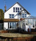 Square thumb mini a hazlemere aluminium conservatory and windows installation after customer landscaped the property