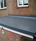 Square thumb fibreglass flat roof finish