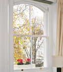 Square thumb 2 over 2 arched head sash window