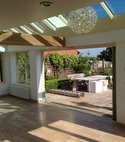 Square thumb orangery with bifold doors to garden