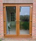 Square thumb golden oak french door
