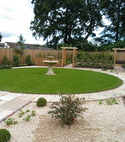Square thumb circular lawn and indian paving with fountain  cove
