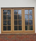 Square thumb irish oak pvcu window with surface mounted georgain bars