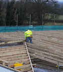 Square thumb  4c  completing timber sub structure to spar shop roof.