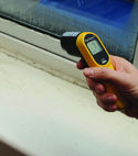 Square thumb testing temperature of mould and condensation on windows.