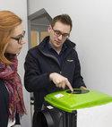 Square thumb ventilation surveyor explaining condensation control unit.