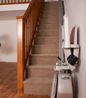 Square thumb acorn straight stairlift folded at the bottom of staircase  1