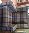 Square thumb wing chair in a wool fabric