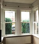 Square thumb vertical slider bay window