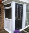 Square thumb porch with composite door