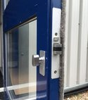 Square thumb dead latch fitted to aluminium door