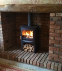 Square thumb brick fireplace