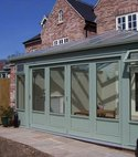Square thumb conservatory hardwood bifold doors