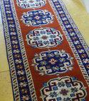 Square thumb rug