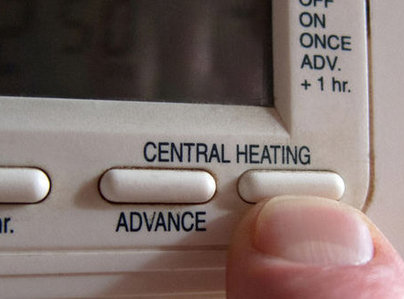 Primary thumb central heating thermostat