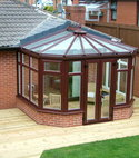 Square thumb woodgrain victorian conservatory to decking