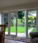 Square thumb bifold look french doors