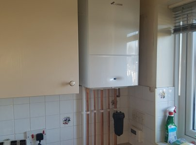 Primary thumb conventional heating system converted to worcester combi boiler in kitchen
