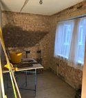 Square thumb exposed brickwork small room