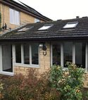Square thumb conservatory with composite windows