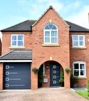 Square thumb ryterna front door   bespke design   matching garage door   anthracite grey