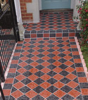Square thumb photo of vintage black and red victorian tiling on front pathway