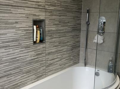 Primary thumb curved bath and screen in grey bathroom by a1gasltd