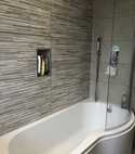 Square thumb curved bath and screen in grey bathroom by a1gasltd