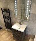 Square thumb vanity unit with lit mirror in bathroom installed by a1 gas ltd   copy