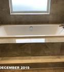 Square thumb sunken bath in modern bathroom by a1 gas ltd