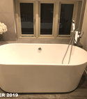 Square thumb free standing bath in modern bathroom by a1 gas ltd
