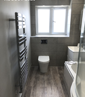 Square thumb toilet and towel rail in bathroom by a1 gas ltd   copy