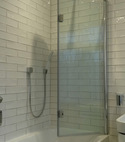Square thumb drench shower over bath