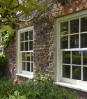 Square thumb traditional timber sash windows in yorkshire property
