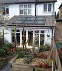 Square thumb single storey rear house extension with velux windows.