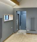 Square thumb vertical electric radiators in grey