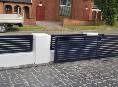 Primary thumb electric sliding gates with matching panels