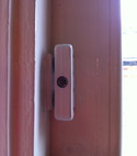 Square thumb wooden window lock closed